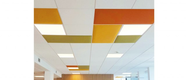 IN SOUND ABSORBING CEILING PANELS